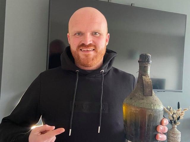 Sam Winter with the iconic 1912 bottle of Benedictine