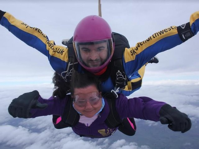Heather conquers her fear in a sky dive with instructor Paul in aid of cancer research.