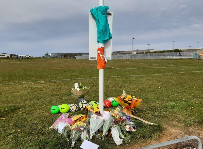 Nine footballs have left in tribute to 9-year-old Jordan Banks, who was struck by lightning during football training on the playing fields