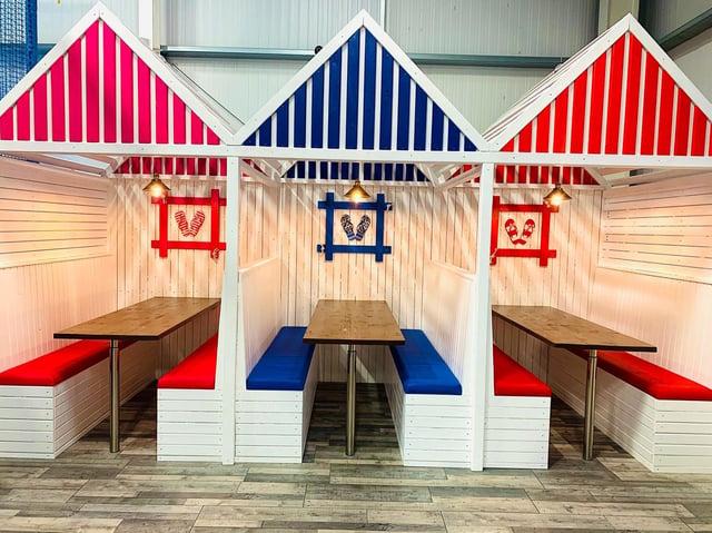 The new beach huts inside Jollies Barn