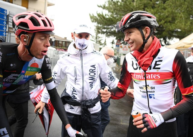 Hugh Carthy with Joe Dombrowski (right) who was unable to ride in stage six following his crash on Wednesday (Getty Images)