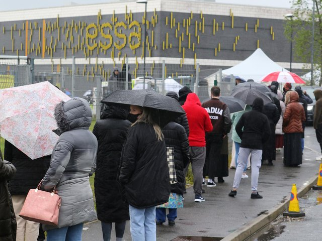 Queues outside the Essa Academy school in Bolton