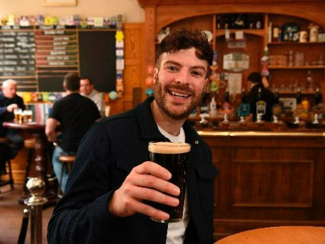 Radio One DJ and former I'm a Celebrity contestant Jordan North enjoys a pint at the Guild Ale House in Preston