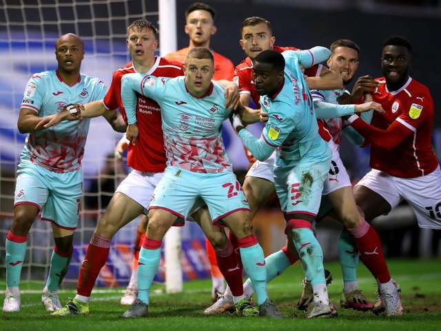 Action from Barnsley's play-off clash with Swansea at Oakwell on Monday night