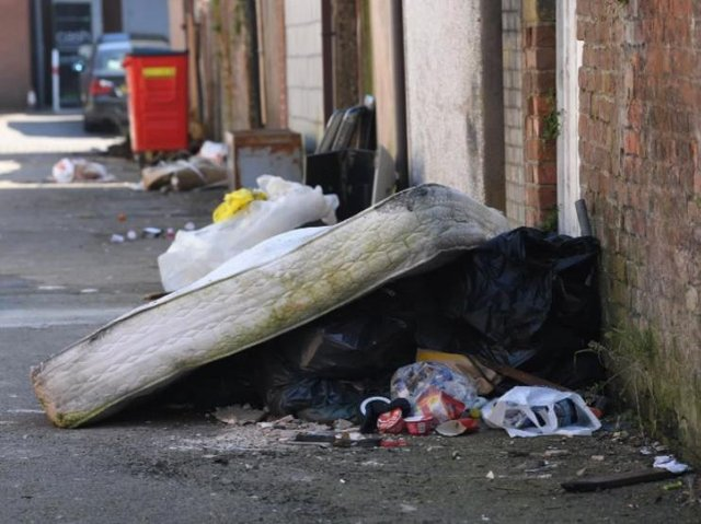 Fly-tipping in a back street off New Hall Lane, Preston.