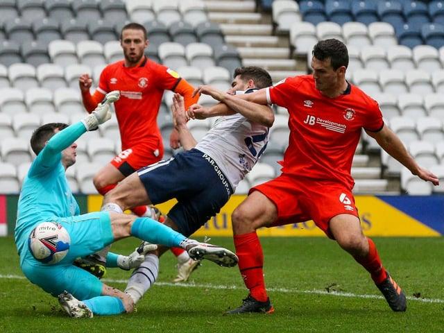 Luton defender Matty Pearson challenges Preston striker Ched Evans at Deepdale