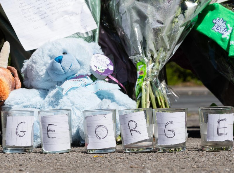 Candle holders with the name George spelled out across them were left in Mallowdale Avenue.