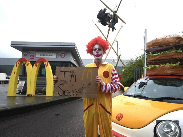 Animal Rebellion protester dressed as a clown