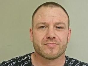 Adrian Snape, 37, from Coppull, has been sentenced to five years and nine months in prison for assaulting police officers, attempted burglary, assault occasioning actual bodily harm, criminal damage and repeatedly breaching a restraining order. Pic: Lancashire Police