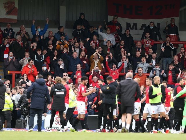 Morecambe's players and supporters celebrate reaching Wembley