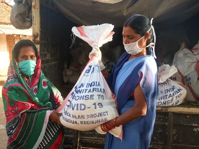 Women receives food kit in Odisha state