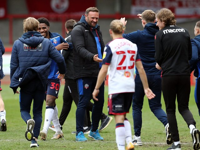 Ian Evatt, centre, celebrates Bolton's promotion with his players