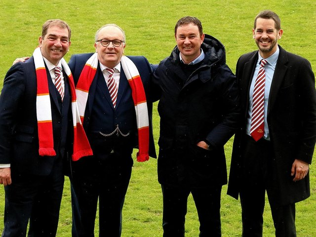 Morecambe's board and manager celebrate reaching Wembley last weekend