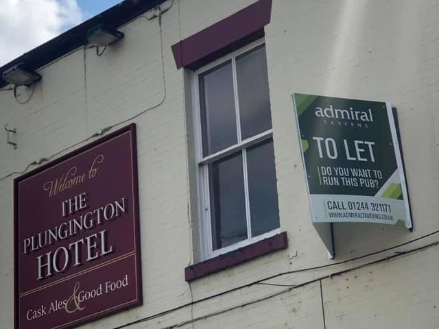 The To Let sign at the pub