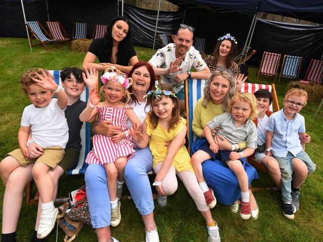 A family has fun at the Love Train Disco at Hoghton Tower.