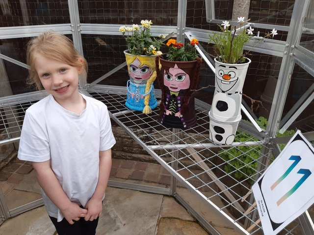 Pupil Cadence Cockburn, with three of the 59 plant pots in the fund-raising trail which is raising money for Brindle Gregson Lane Primary School