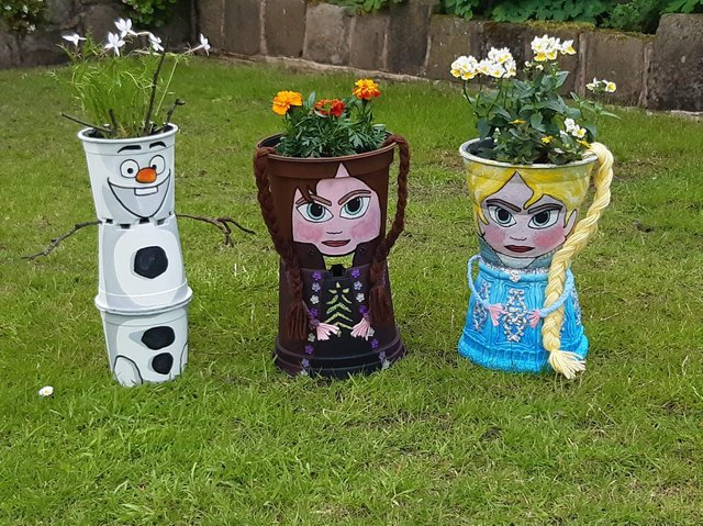 Here's just three of the plant pot characters people can see on the Brindle Gregson Lane in Bloom Trail
