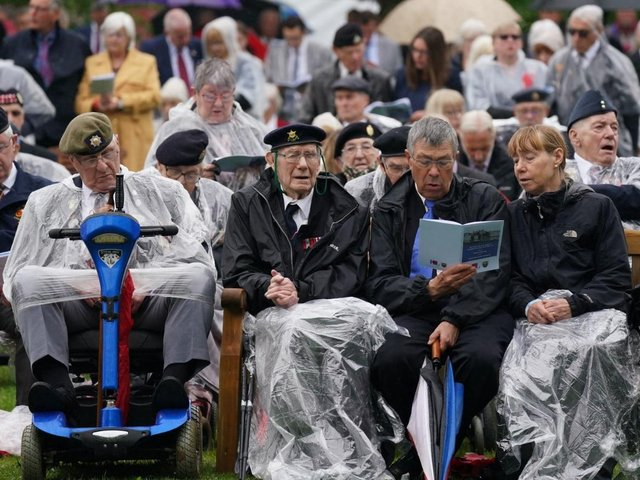Veterans watch the official opening of the British Normandy Memorial in France via a live feed during a ceremony at the National Memorial Arboretum in Alrewas, Staffordshire