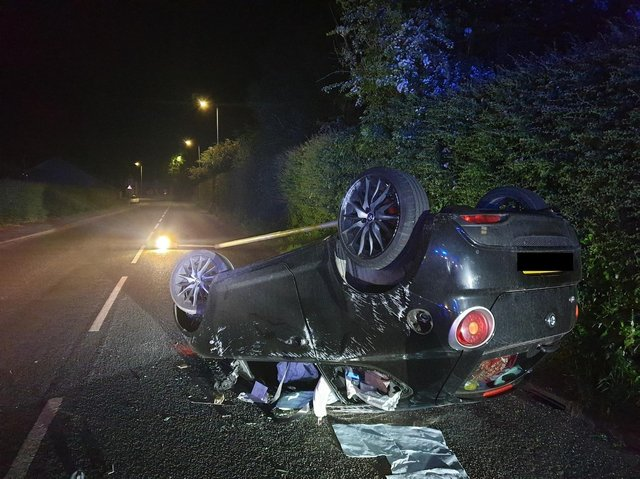 The wreckage of the black car after the incident over the weekend