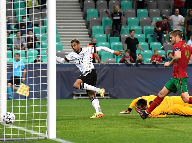 Lukas Nmchea scores Germany's winner against Portugal in the European Under-21s Championship final