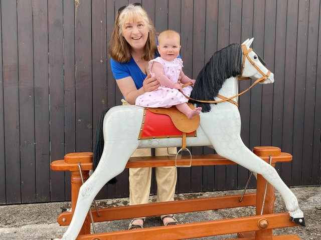 Sandra Cunningham with Sophia and the rocking horse