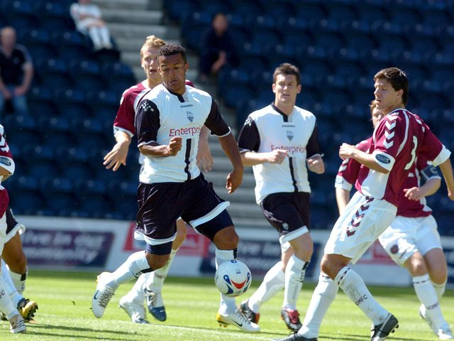 Preston North End winger Simon Whaley evades the attention of the Hearts defence to score at Deepdale in July 2006