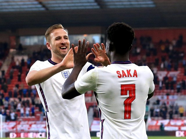 England's Bukayo Saka (right) celebrates with team-mate Harry Kane after scoring their side's first goal of the game during the International Friendly at The Riverside Stadium, Middlesbrough.  Wednesday June 2, 2021.  PHOTO: Lindsey Parnaby/PA Wire.
