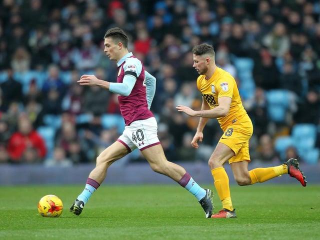 Aston Villa's Jack Grealish is chased by Preston North End midfielder Alan Browne