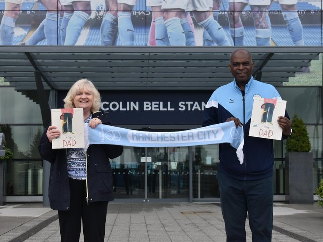 Author Susan Quinn with Manchester City ex-goalie Alex Williams MBE - and her late dad's beloved team scarf - outside the Etihad Stadium.