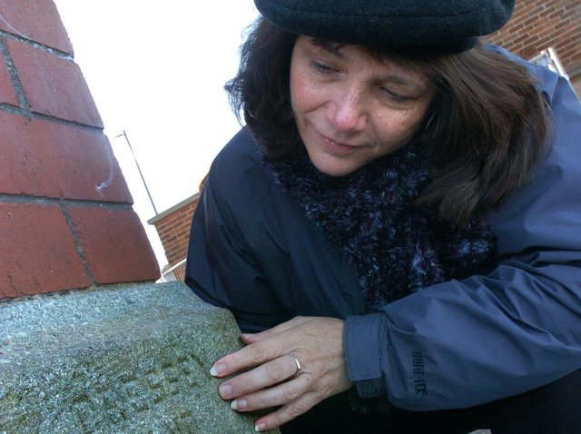 Pamela Cressey from California find her grandfather's name on Morecambe's clock tower, which he helped design.