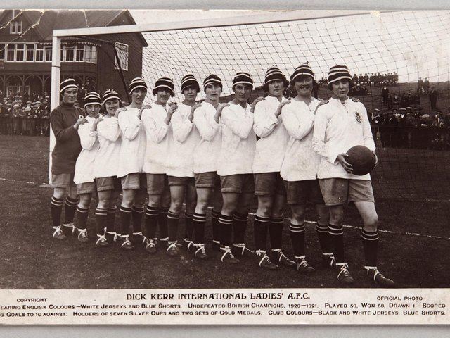 The Dick, Kerr team with Lily Parr at the front holding the ball