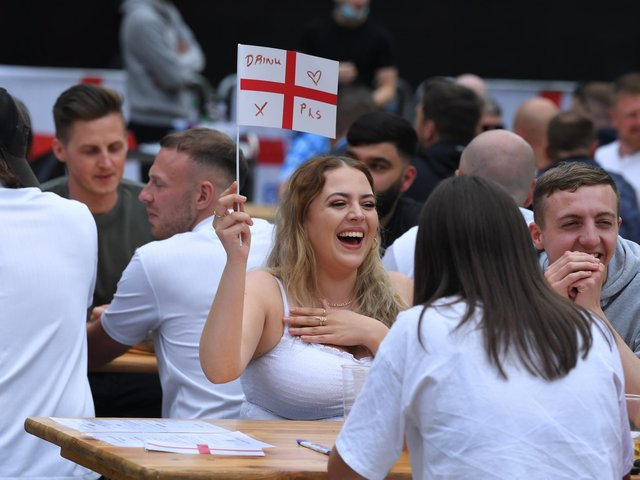 Fans watching the England v Scotland match at Flag Market Fans Zone