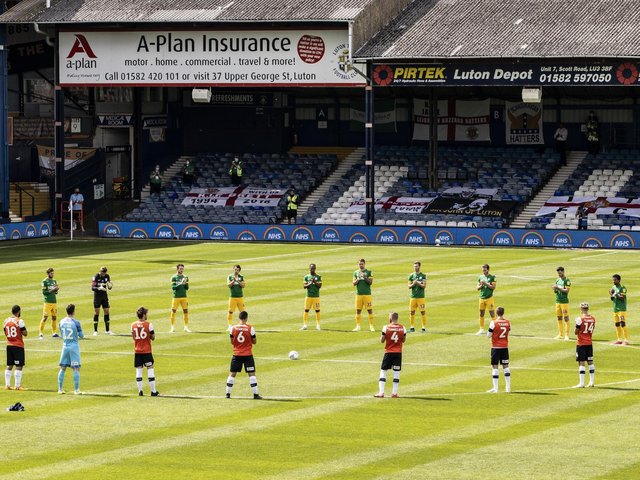 Preston North End and Luton Town players applause NHS workers ahead of he restart game at Kenilworth Road in June 2020