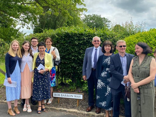 Remembered with love  and with  gratitude for his parish work.  Bob Barron's wife Moira, daughters Louise and Lucy, son-in-law Peter and grandchildren Luke, Mary and Helena  are pictured  with Mike and Bridget Bryan at the naming ceremony.