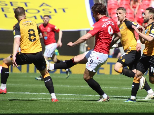 Cole Stockton is one of last season's promotion winners to sign a new deal with Morecambe
