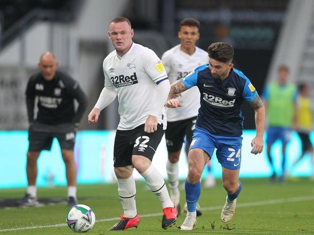Preston North End striker Sean Maguire tracks Wayne Rooney in PNE's Carabao Cup win at Pride Park last season