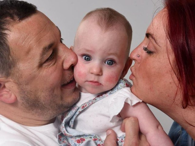 Parents Jade and Stuart enjoy life with baby Stella at home following months of treatment