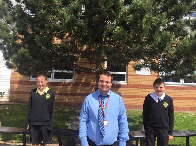 Summer school leader and 2nd in Maths Mr Fern and two volunteers from the school , Holly Moffatt and Theo May.