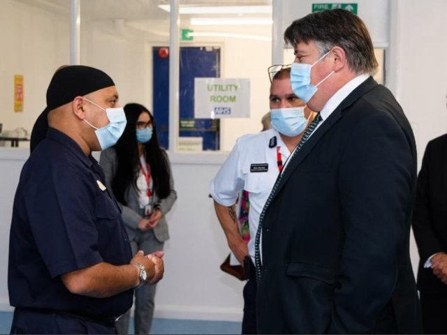 Minister Lord Greenhalgh chats with Faz Patel from the Lancashire Fire and Rescue Service.