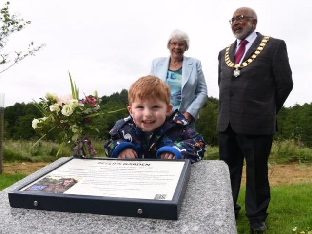 Great grandson Finley, two, at the unveiling of the memorial garden with Peter's widow Nora and Preston Mayor Coun Javed Iqbal.