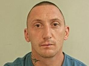 Preston man Oliver Bland, 38, is wanted in connection with a number of offences, including an assault in Bamber Bridge last weekend, where a man had his ear bitten off. Pic: Lancashire Police