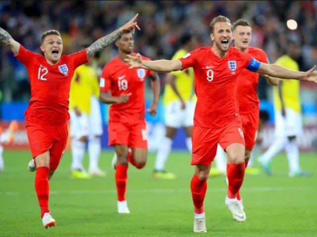 England players celebrate winning their last penalty shoot-out against Colombia in the 2018 World Cup.