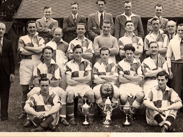 Photograph of Caton United 1948-1949 at Jowett's Field, Caton, with a clean sweep of  trophies won in that season, Division1 title, Parkinson Cup & Senior Challenge Cup.Back row from left: Dick Woolcock, George Wilson, Stanley Walker, Bill Dainty, George Robinson. Middle row from left: Tom Eglin, Bill Hodgson, Jimmy Till, Jimmy Clarkson, Bert Cartmel, Albert Robinson, R. Bowker, Ritson Stockdale, Sid Southward  Front row from left: Fred Robinson, Joe Easterby, Jock Kerr (captain), Ted Fairclough, Cyril Gardner. Sat on the ground from left: Jimmy Mason, Frank Woodhouse.