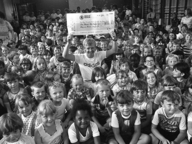 A hush-marathon by a bunch of schoolkids will help to boost the long fight against a killer disease. For around 300 children at Greenlands Primary School, Ribbleton, Preston, raised more than £1,300 for the fight against leukaemia, by holding a sponsored silence. And to put a smile on everyone's face when the cheque was handed over was comedian Les Dennis, who is starring in Blackpool. He is pictured holding the cheque which he received on behalf of the Manchester Children's Hospital Bone Marrow Transplant fund