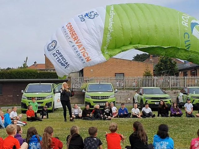 Human Swan Sacha Dent at Trumacar school meeting pupils. Sacha is attempting to be the first to circumnavigate the mainland of Britain using an electric paramotor. Picture by Peter Storry.