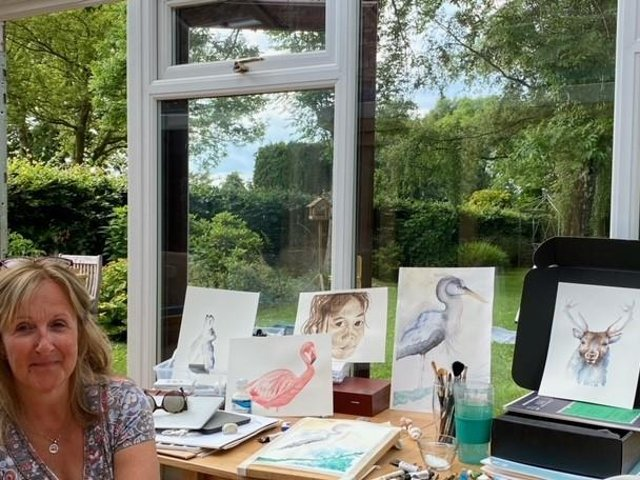 Frances Hamer with some of her paintings
