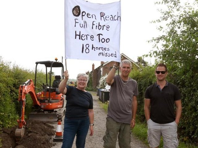 Photo Neil Cross; Barbara and Richard Farbon with Gavin Hughes protesting against Open Reach in Bretherton