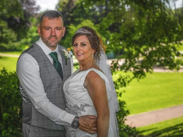 Tracy and David tied the knot after rescheduling their wedding twice. Photo by Paul King photography