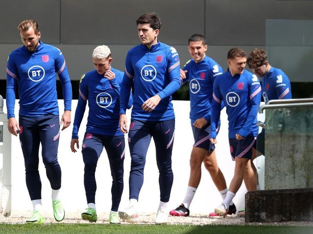 Harry Kane, Phil Foden and Harry Maguire of England and teammates take to the field during the England Training Session at St George's Park on July 05