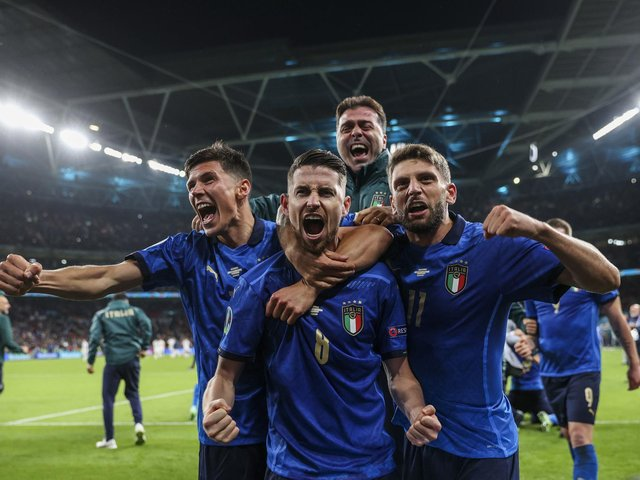 Italy celebrate their shootout victory over Spain and a return to Wembley for Sunday's final